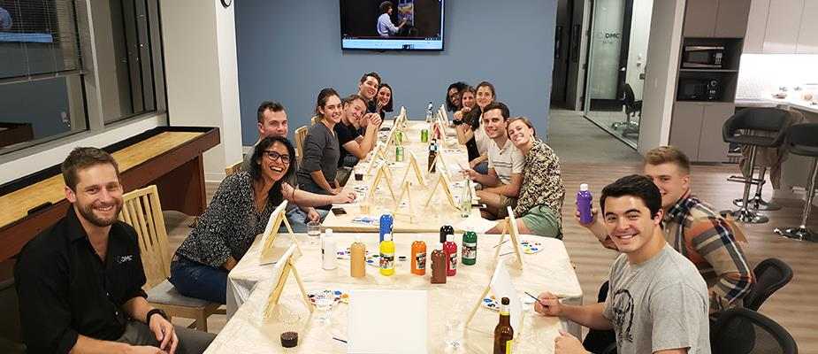 Houston Welcomes New Employees with a Bob Ross-inspired Painting Party