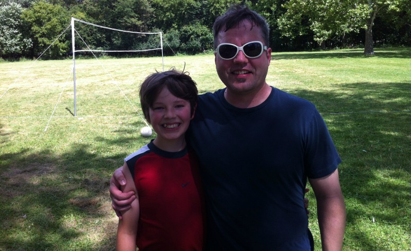 DMC Chicago engineer John Toljanic and his son play volleyball.
