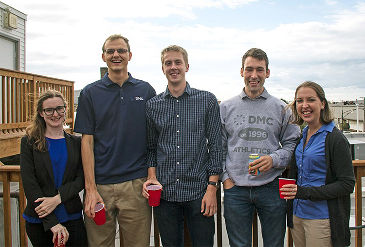 Photo of new hires at DMC's 21st birthday party.