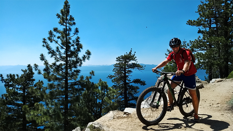 Photo of Andrew Crowley on a mountain bike on the Flume Trail.