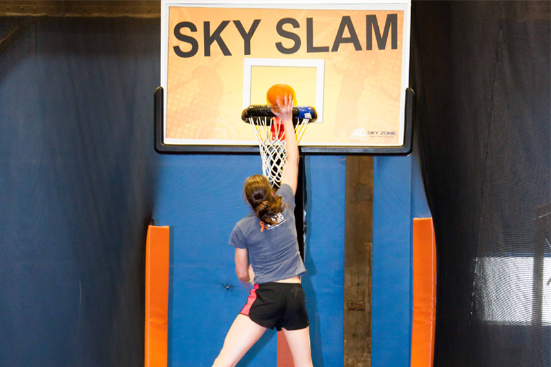 Systems Engineer Erin Meyer does a sweet slamdunk at SkyZone.
