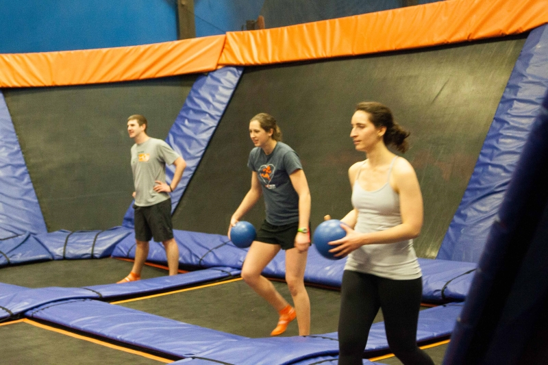 The group prepares for a game of dodgeball at SkyZone.