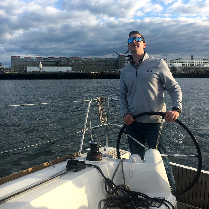 Photo of Dan captaining a DMC boat outing.