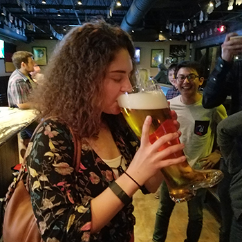 Cecilia Brookshire drinks from a glass boot at Bar Munich in Midtown Houston during the Houston YOE Peddle Pub Party.