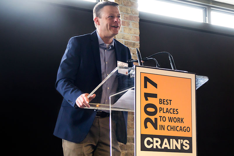Rick Rietz accepts DMC's Best Places to Work in Chicago award