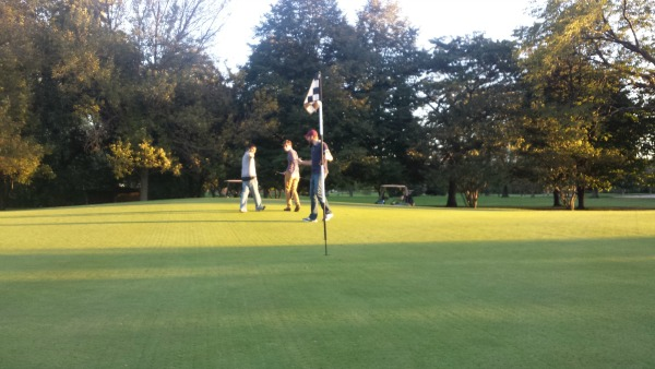 DMC engineers hit around the ball at a local golf course.