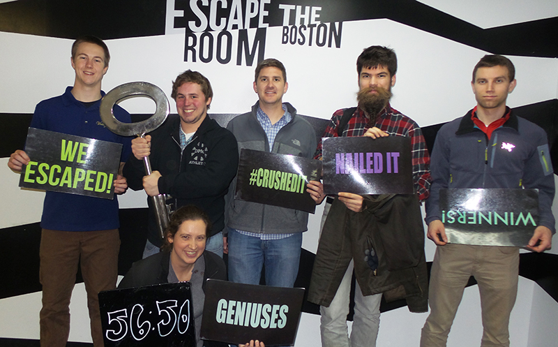 DMC Boston's team after escaping the room with lots of fun signs and props