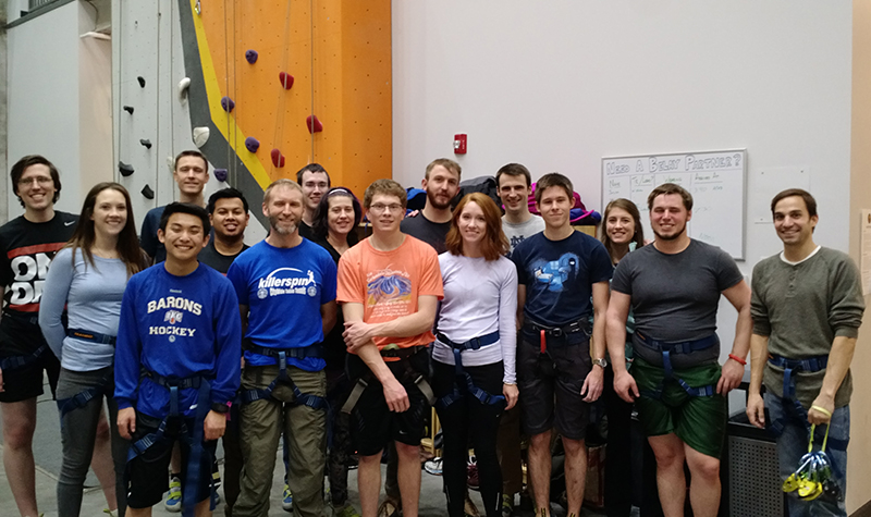 DMC Chicago poses for a group picture at First Ascent's rock climbing gym