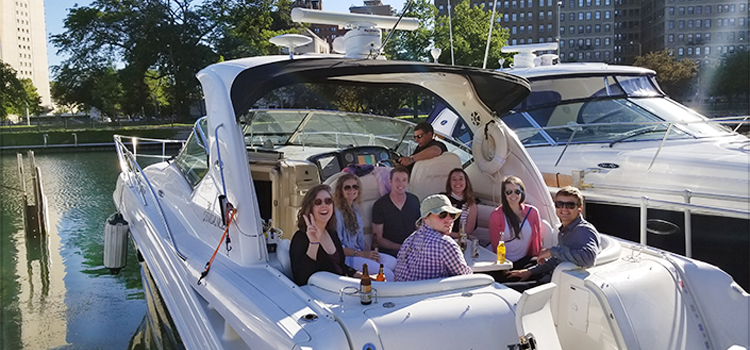 Photo of DMC employees and friends relaxing on Frank's boat.
