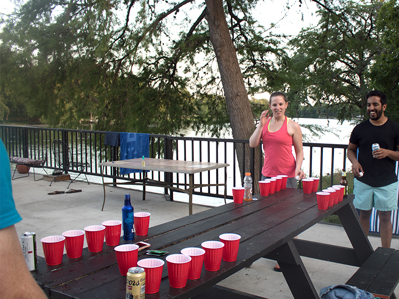 Playing beer pong at the Houston YOE.