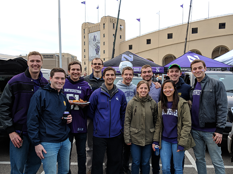 Group photo of DMC employees at Northwestern tailgating.
