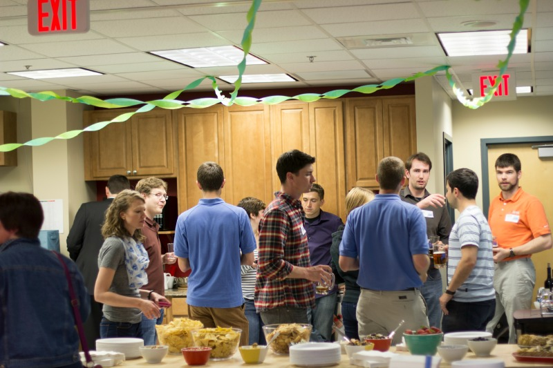 DMC employees congregate in the kitchen for food and drinks.