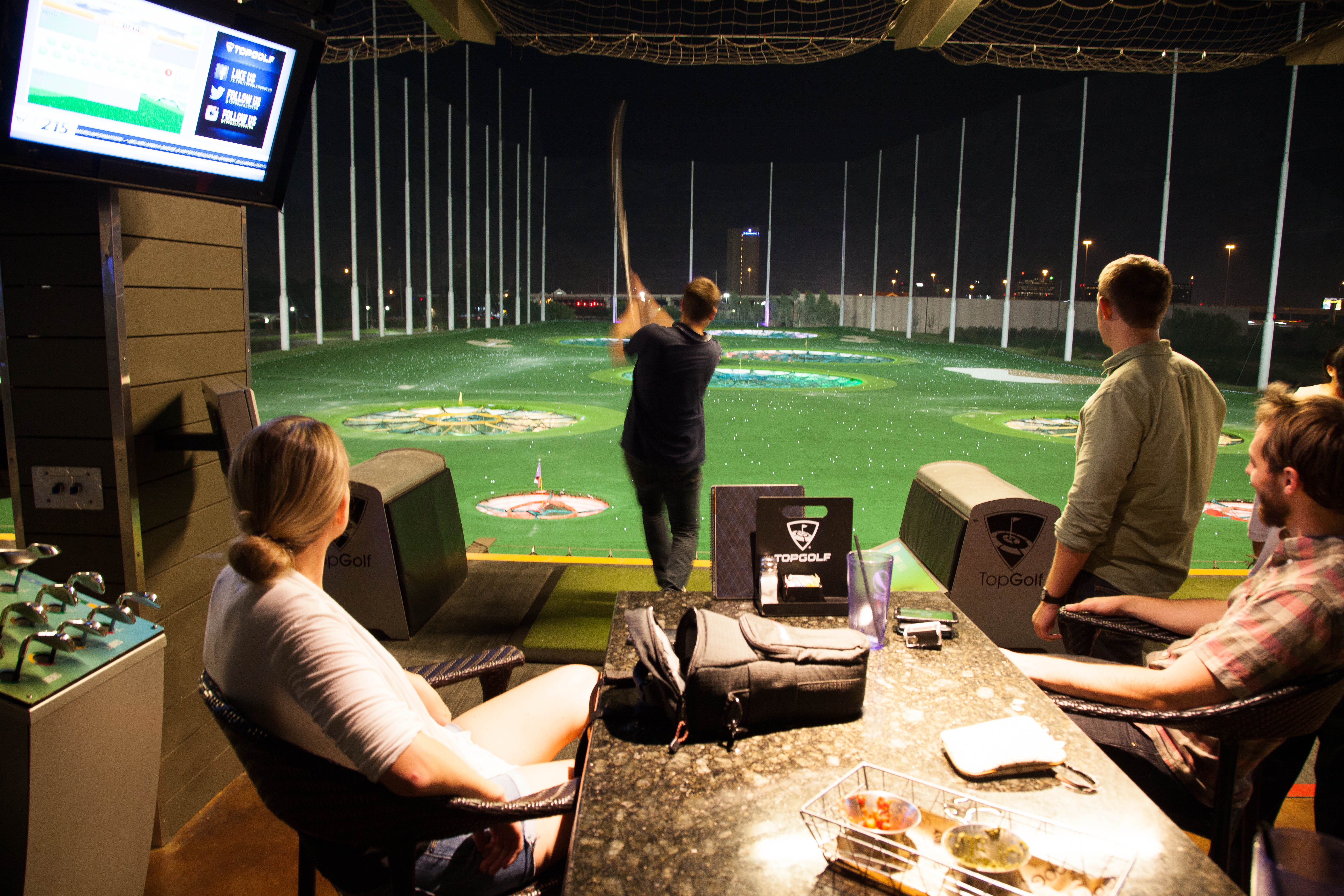 The DMC Houston team enjoys a round of Top Golf