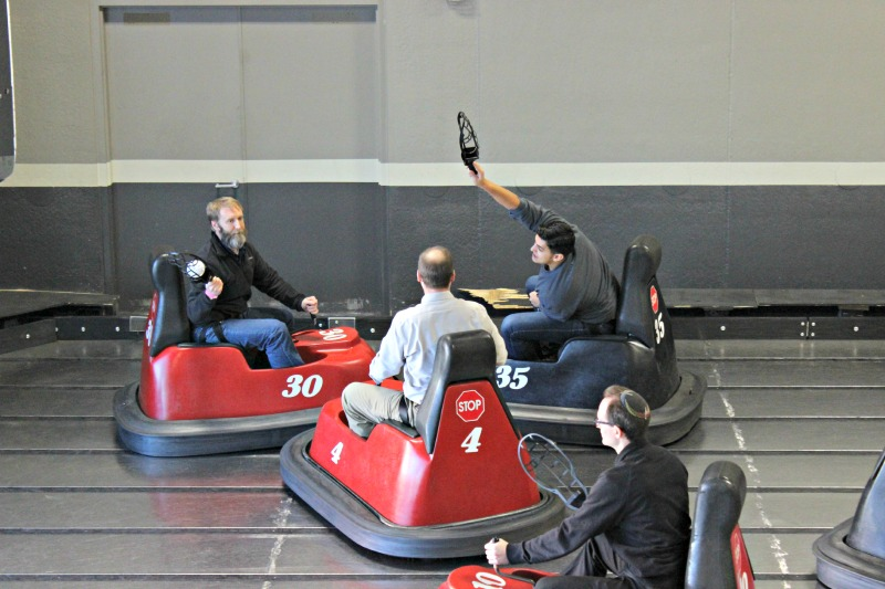 Accounting Assistant Chris Vasquez attempts to block a pass on the WhirlyBall court.