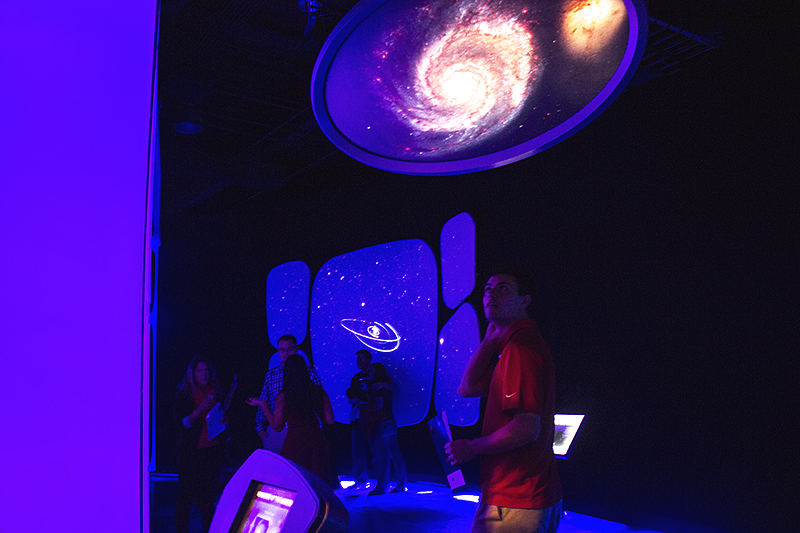 DMC employee Jason W. wandering around the Milky Way at a welcome party at the Adler Planetarium.