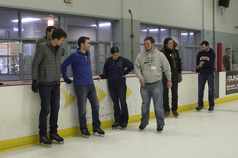 DMC Chicago employees socializing on the ice rink