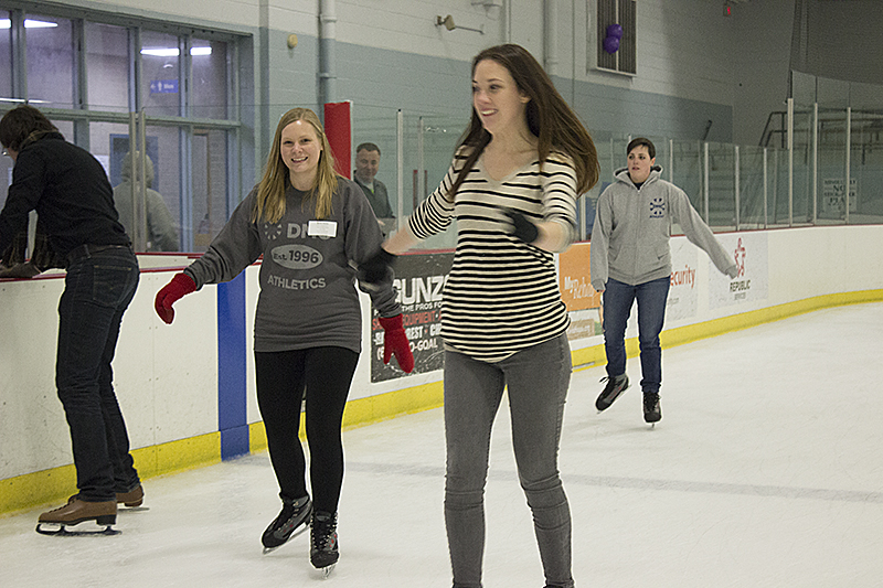 DMC Chicago employees ice skating during the All Day Company Meeting