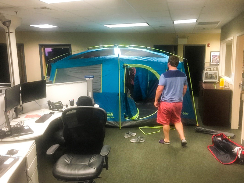 Photo of DMC Boston's tent set up in the office.