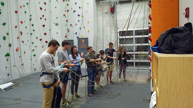 DMC learning how to tie knots for rock climbing