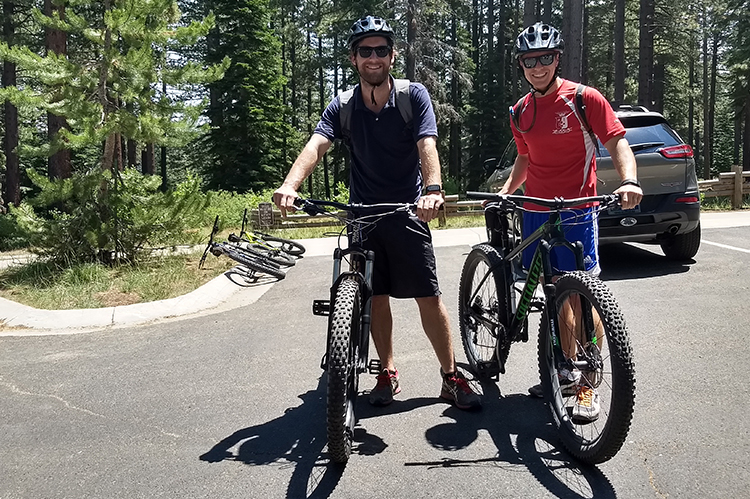 Photo of Leigh Matthews and Andrew Crowley with their mountain bikes.
