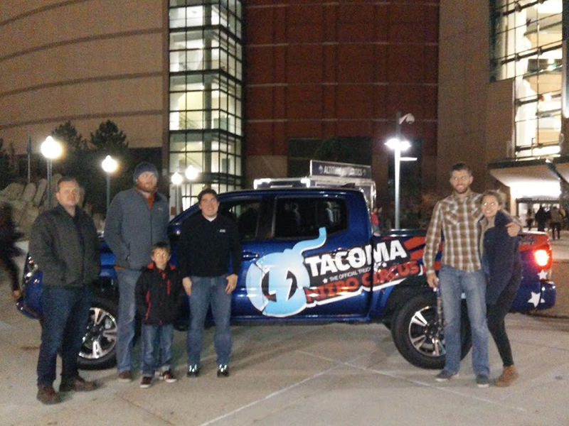 Some of DMC's Denver office and their guests posing outside of the stadium at Nitro Circus