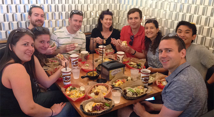 DMC Houston attendees enjoy tacos around a table at Torchy's Tacos.