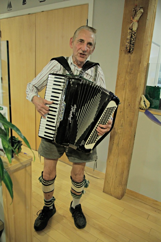 The accordian player performs for DMC employees and guests.