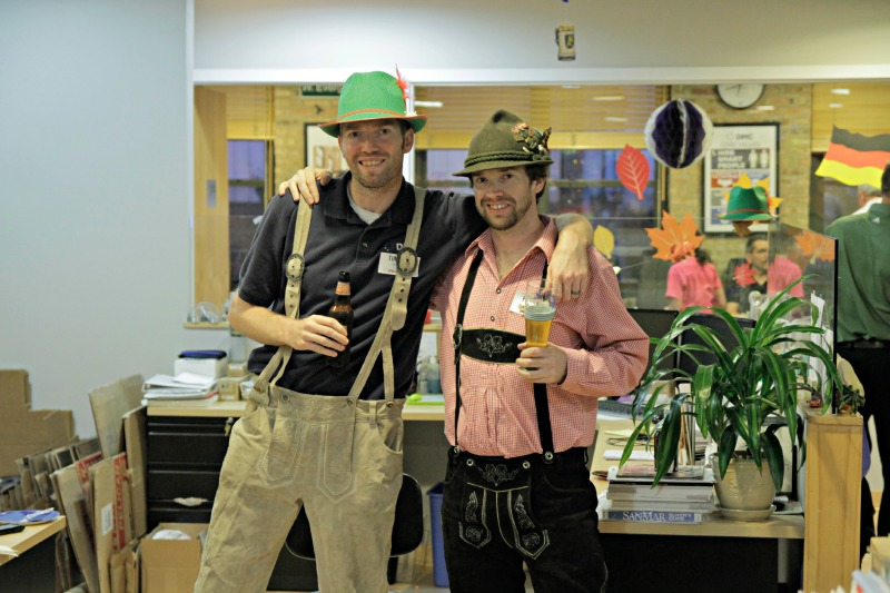Two engineers pose in their lederhosen at DMC,
