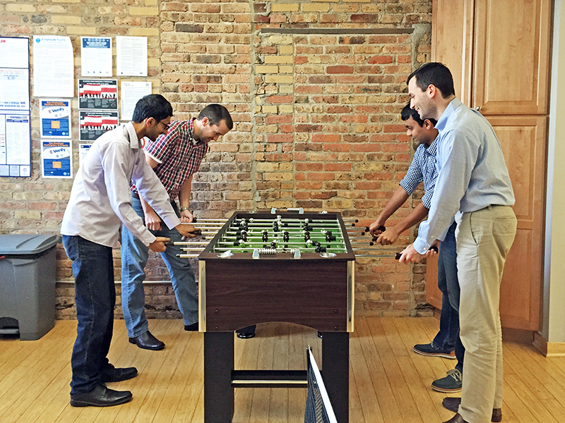 DMC employees play foosball together during a Friday happy hour.