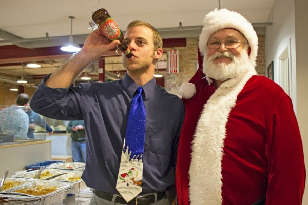 DMC engineer, Mark, throws back a beer with Santa.