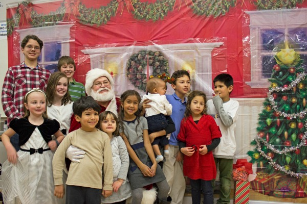 Children of DMC engineers and consultants smile with Santa.