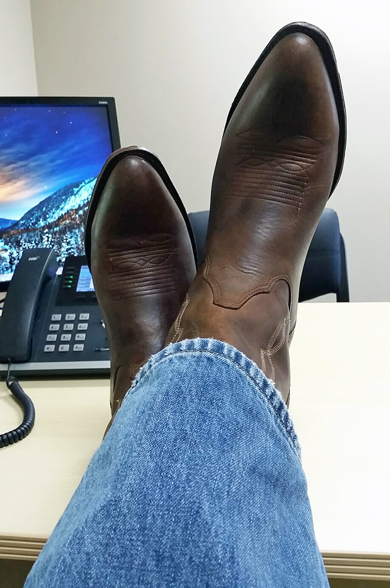 DMC Houston has taken to wearing cowboy boots