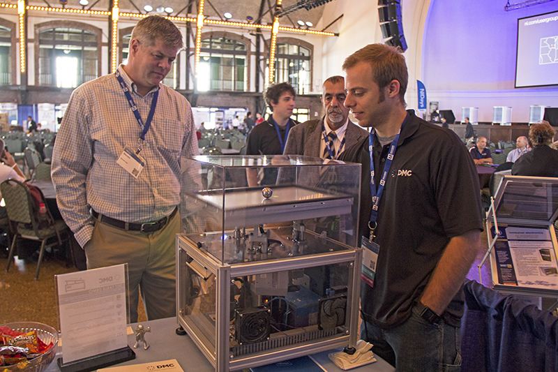 Attendees of NIDays Chicago 2015 view the tilt table demo at DMC's booth